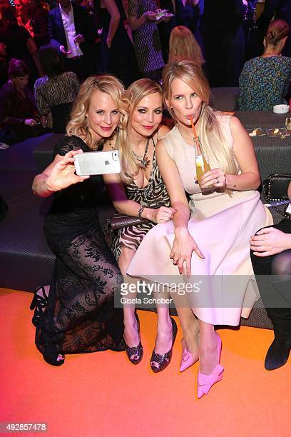 Designer Sonja Kiefer Regina Halmich and Monica Ivancan are doing a selfie during the Tribute to Bambi 2015 after show party at Station on October 15...