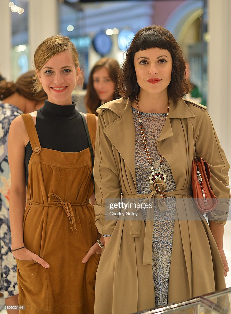 Designer Sophie Buhai (L) and Sophia Amoruso attend Barneys New York Cocktail Event with Simon Doonan and 'Man Repeller' Leandra Medine at Barneys New York At The Grove on September 17, 2013 in Los Angeles, California.