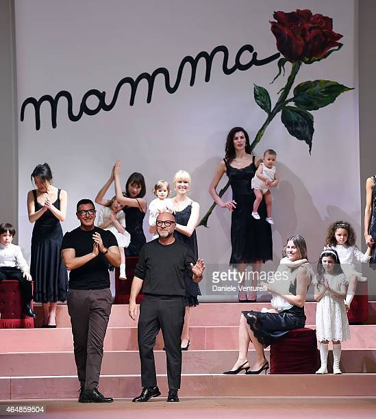 Designer Stefano Gabbana and Domenico Dolce acknowledges the applause of the audience after the Dolce Gabbana show during the Milan Fashion Week...