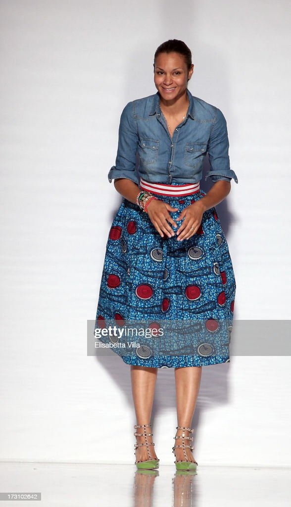 Designer Stella Jean acknowledges the public during It's Ethical Fashion 'Bring Africa to Rome' catwalk collection S/S 2014 fashion show as part of AltaRoma AltaModa Fashion Week at Santo Spirito In Sassia on July 7, 2013 in Rome, Italy.