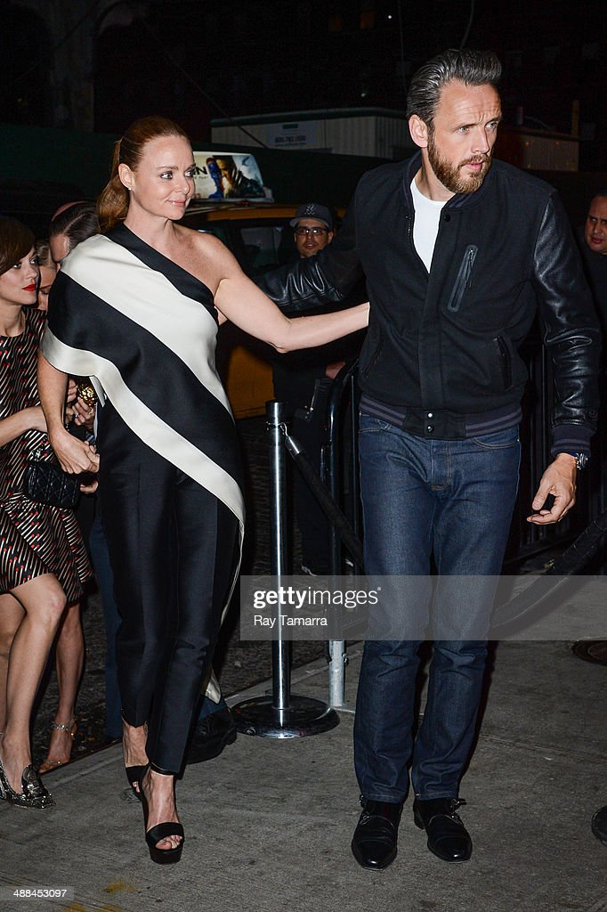 Designer Stella McCartney (L) and Alasdhair Willis enter the 'Charles James: Beyond Fashion' Costume Institute Gala after party at the Boom Boom Room on May 5, 2014 in New York City.
