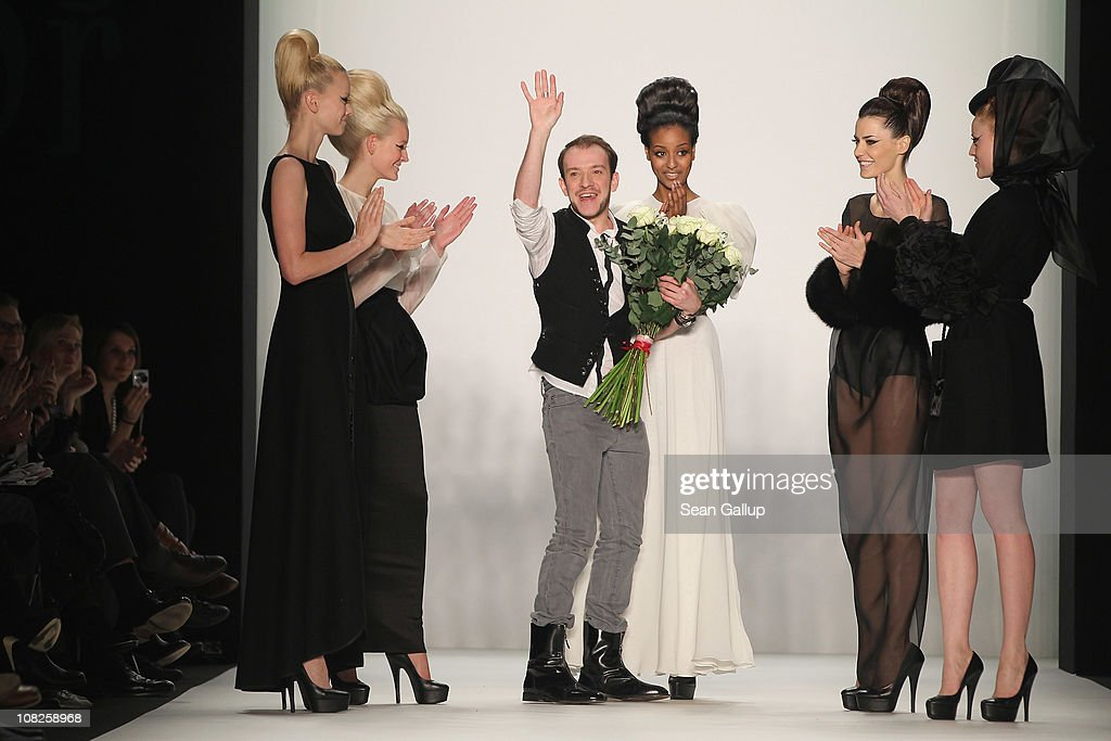 Designer Stephan Pelger receives applause following the Stephan Pelger Show during the Mercedes Benz Fashion Week Autumn/Winter 2011 at Bebelplatz on January 22, 2011 in Berlin, Germany.