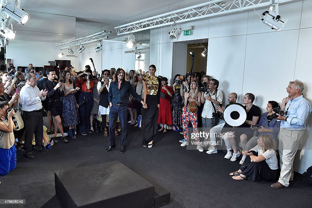 Designer Stephane Rolland walks the runway during the Stephane Rolland show as part of Paris Fashion Week Haute Couture Fall/Winter 2015/2016 on July...