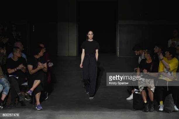 Designer Stephanie Hahn acknowledges the audience during the 22/4_Hommes Menswear Spring/Summer 2018 show as part of Paris Fashion Week on June 23...