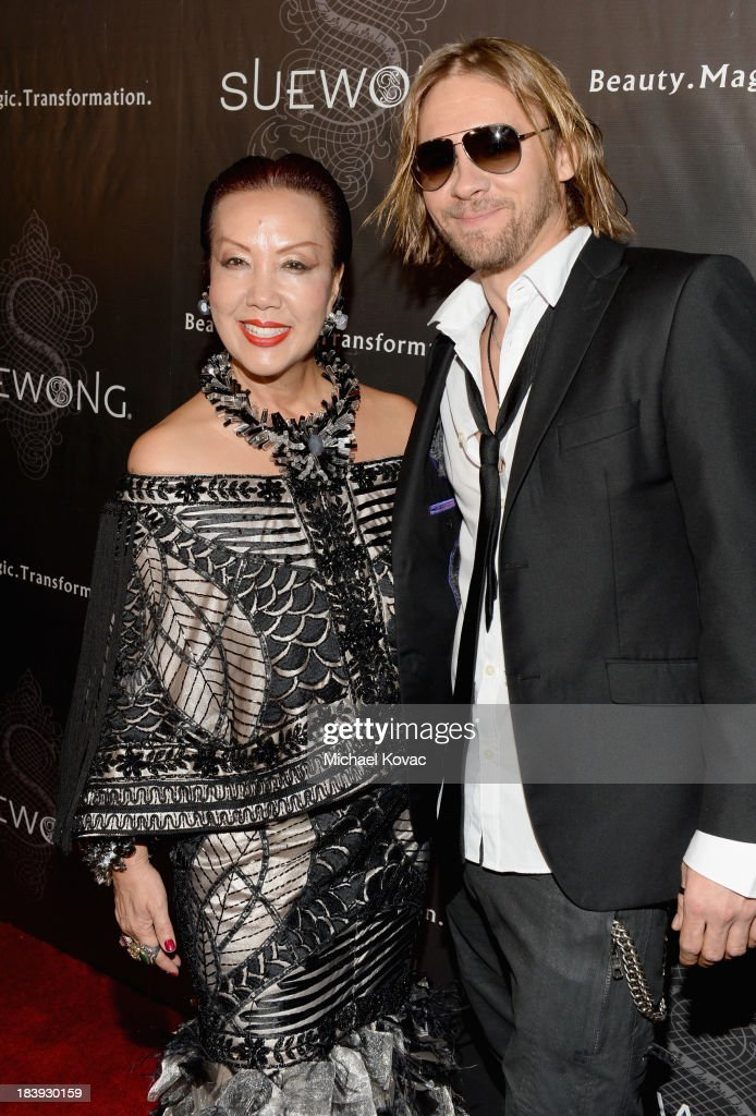 Designer Sue Wong (L) and actor Kayd Currier attend Sue Wong 'Jazz Babies' Spring 2014 Runway Show on October 9, 2013 in Los Angeles, California.