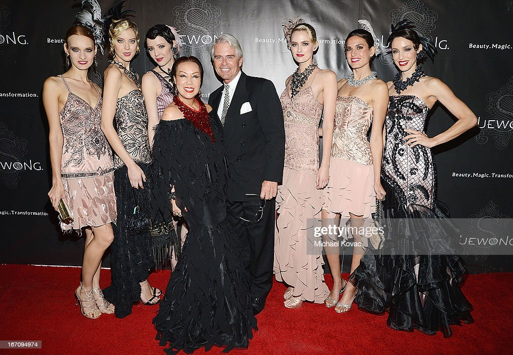 Designer Sue Wong (4th L) and actor Robert Frank Telfer (4th R) pose with models at the Sue Wong Fall 2013 Great Gatsby Collection Unveiling and Birthday Celebration on April 19, 2013 in Los Angeles, California.