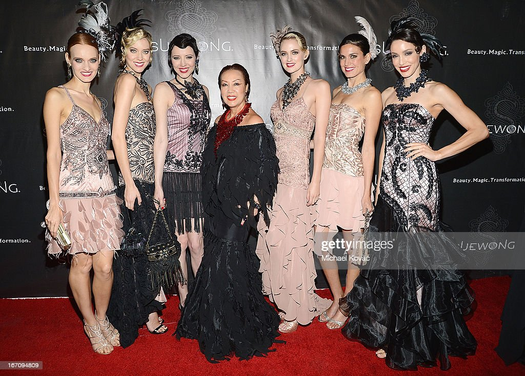 Designer Sue Wong (C) poses with models at the Sue Wong Fall 2013 Great Gatsby Collection Unveiling and Birthday Celebration on April 19, 2013 in Los Angeles, California.