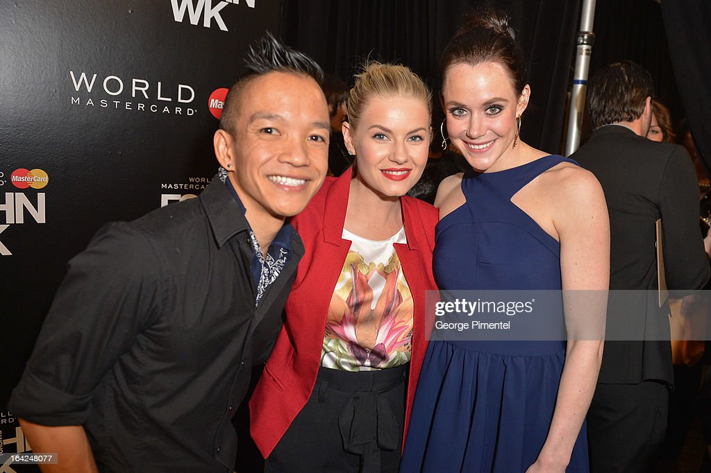 Designer Sunny Fong, actress Elisha Cuthbert and <a gi-track='captionPersonalityLinkClicked' href=/galleries/search?phrase=Tessa+Virtue&family=editorial&specificpeople=793314 ng-click='$event.stopPropagation()'>Tessa Virtue</a> attend World MasterCard Fashion Week Fall 2013 at David Pecaut Square on March 21, 2013 in Toronto, Canada.