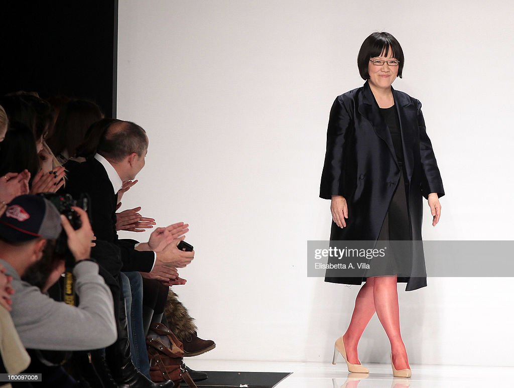 Designer Suzanne Susceptible acknowledges the applause of the public after her F/W 2013-14 preview colletion fashion show as part of AltaRoma AltaModa Fashion Week at Santo Spirito In Sassia on January 26, 2013 in Rome, Italy.