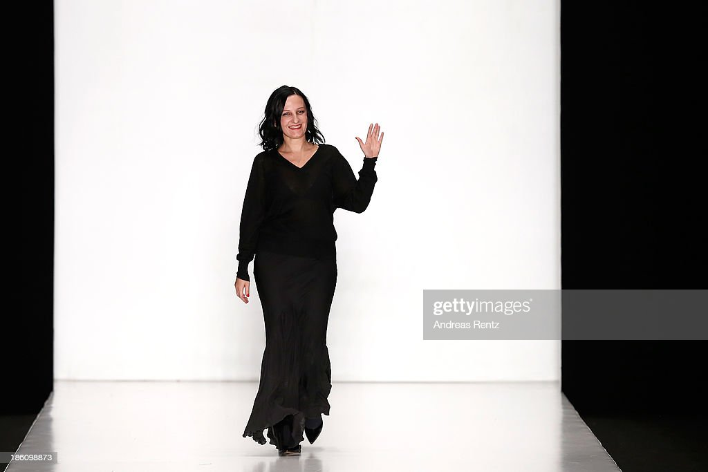 Designer Svetlana Tegin walks the runway for the finale of the Tegin show during Mercedes-Benz Fashion Week Russia S/S 2014 on October 28, 2013 in Moscow, Russia.