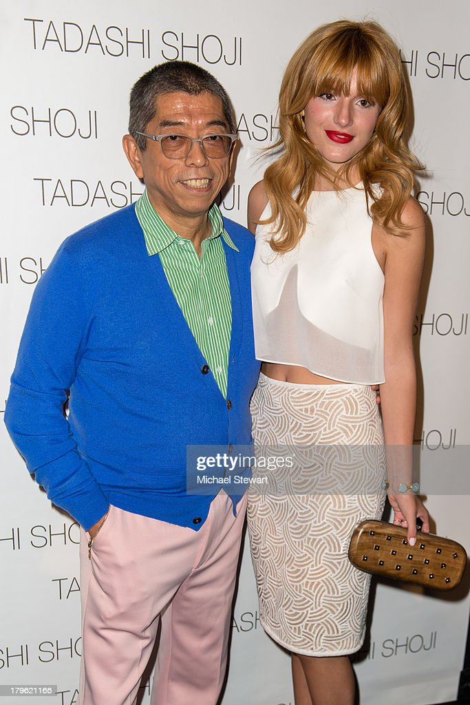 Designer Tadashi Shoji (L) and actress Bella Thorne attend the Tadashi Shoji show during Spring 2014 Mercedes-Benz Fashion Week at The Stage at Lincoln Center on September 5, 2013 in New York City.