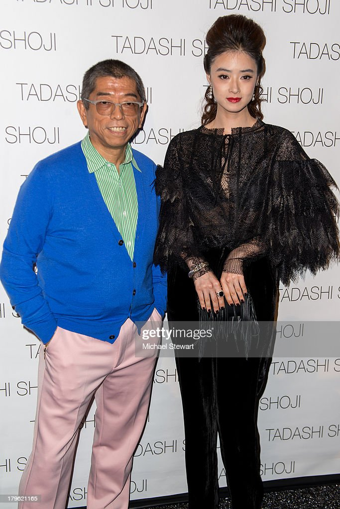 Designer Tadashi Shoji (L) and actress Jiang Xin attend the Tadashi Shoji show during Spring 2014 Mercedes-Benz Fashion Week at The Stage at Lincoln Center on September 5, 2013 in New York City.