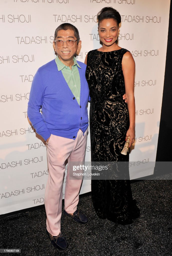 Designer Tadashi Shoji and actress <a gi-track='captionPersonalityLinkClicked' href=/galleries/search?phrase=Rochelle+Aytes&family=editorial&specificpeople=843599 ng-click='$event.stopPropagation()'>Rochelle Aytes</a> prepare backstage at the Tadashi Shoji Spring 2014 fashion show during Mercedes-Benz Fashion Week at The Stage at Lincoln Center on September 5, 2013 in New York City.