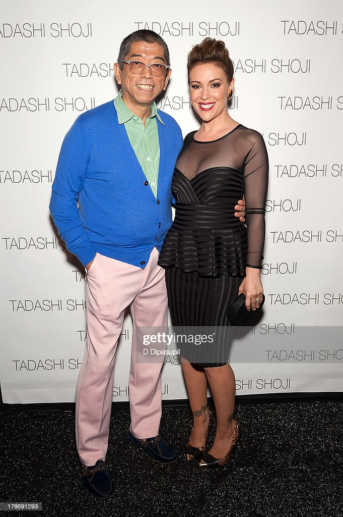 Designer Tadashi Shoji (L) and <a gi-track='captionPersonalityLinkClicked' href=/galleries/search?phrase=Alyssa+Milano&family=editorial&specificpeople=203329 ng-click='$event.stopPropagation()'>Alyssa Milano</a> attend the Tadashi Shoji Spring 2014 fashion show at The Stage Lincoln Center on September 5, 2013 in New York City.