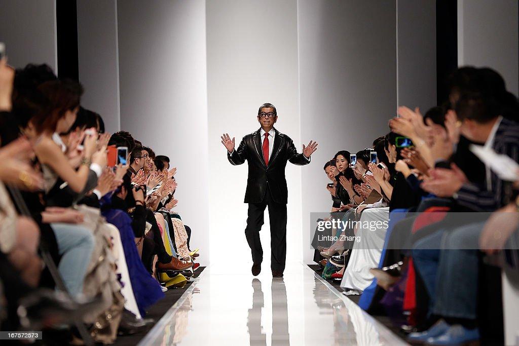 Designer Tadashi Shoji attends the Tadashi Shoji Beijing Store Grand Opening at Beijing Parkview Green on April 26, 2013 in Beijing, China.