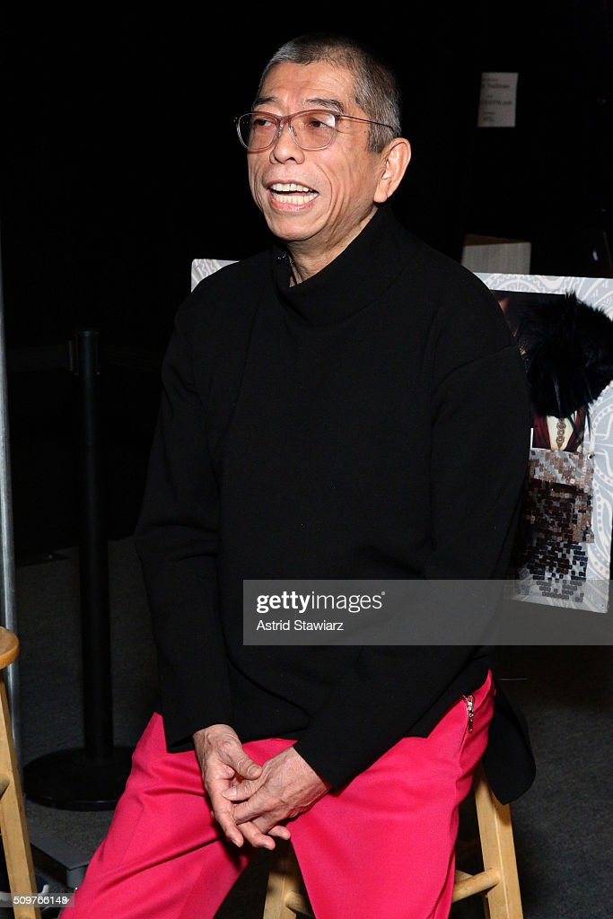 Designer Tadashi Shoji prepares backstage at the Tadashi Shoji Fall 2016 fashion show during New York Fashion Week: The Shows at The Arc, Skylight at Moynihan Station on February 12, 2016 in New York City.