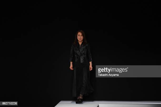 Designer Tae Ashida takes applause from the audience on the runway during the TAE ASHIDA show as part of Amazon Fashion Week Tokyo 2018 S/S at Grand...