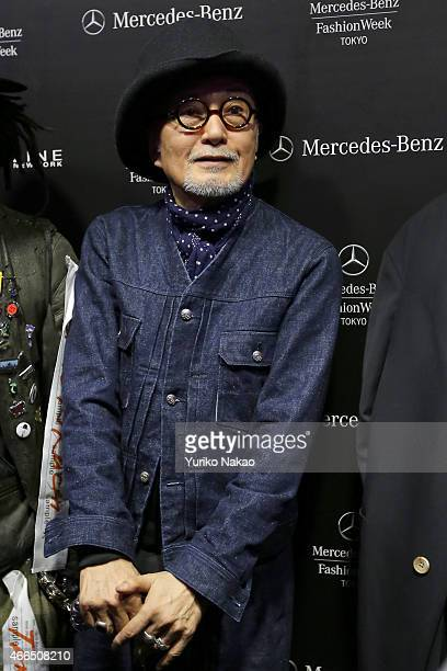 Designer Takeo Kikuchi speaks to the media after his TAKEO KIKUCHI show as part of Mercedes Benz Fashion Week TOKYO 2015 A/W at Shibuya Hikarie on...