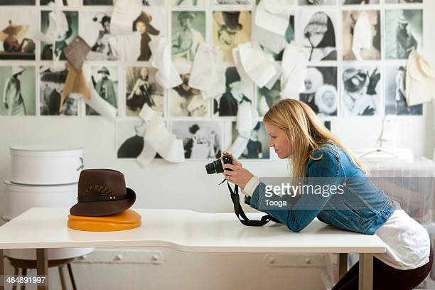 Designer taking picture of hat
