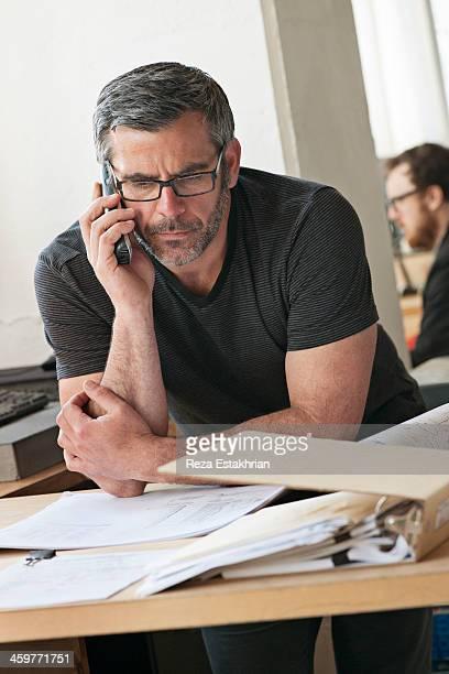 Designer talks on telephone