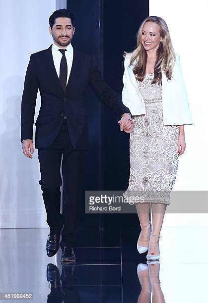 Designer Tamara Ralph and Michael Russo salute the public on the runway after their show Ralph Russo show as part of Paris Fashion Week Haute Couture...