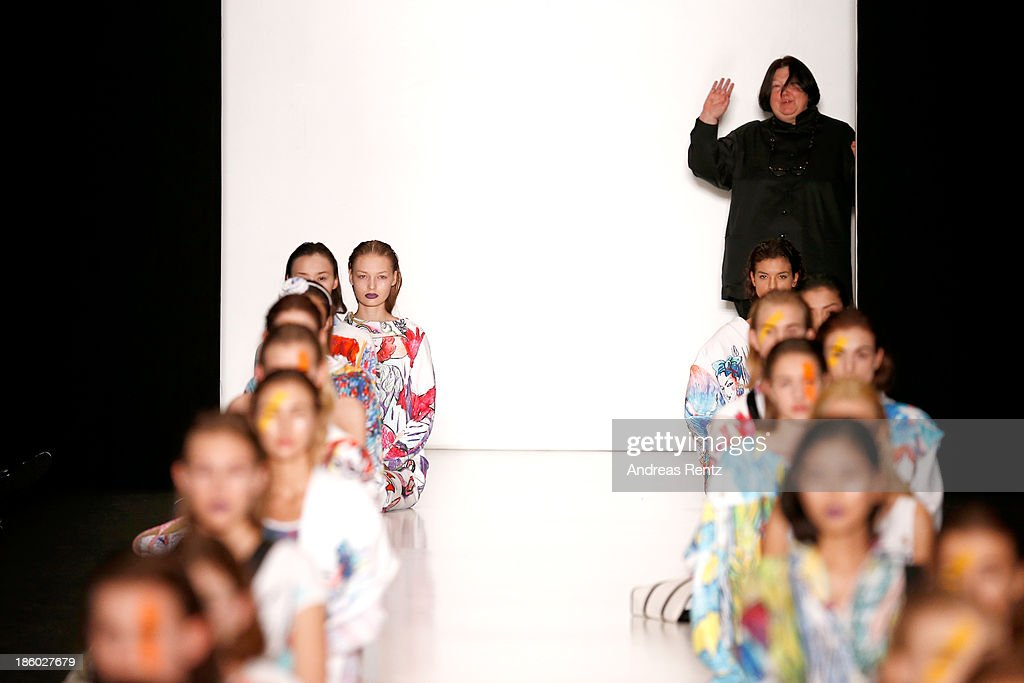 Designer Tatyana Parfionova acknowledges the applause of the audience after the Tatyana Parfionova show during Mercedes-Benz Fashion Week Russia S/S 2014 on October 27, 2013 in M