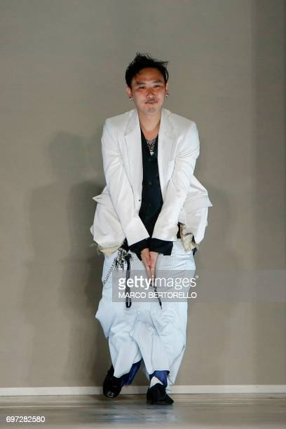 Designer Teppei Fujita greets the audience at the end of the show for fashion house Sulvam during the Men's Spring/Summer 2018 fashion shows in Milan...