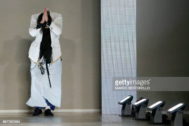 TOPSHOT Designer Teppei Fujita greets the audience at the end of the show for fashion house Sulvam during the Men's Spring/Summer 2018 fashion shows...