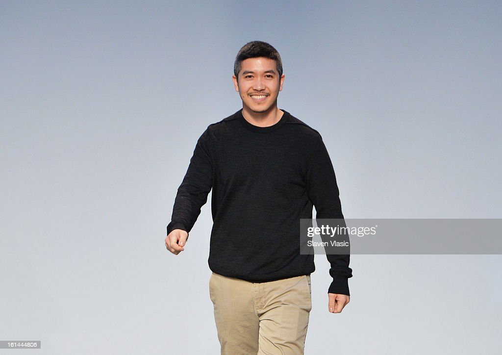 Designer Thakoon Panichgul walks the runway at the Thakoon fall 2013 fashion show during Mercedes-Benz Fashion Week at the Dia Art Foundation on February 10, 2013 in New York City.