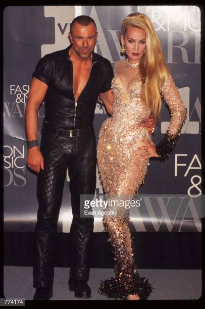 Designer Thierry Mugler stands with model Jerry Hall at the 1995 VH1 Fashion and Music Awards December 3 1995 in New York City The awards show...