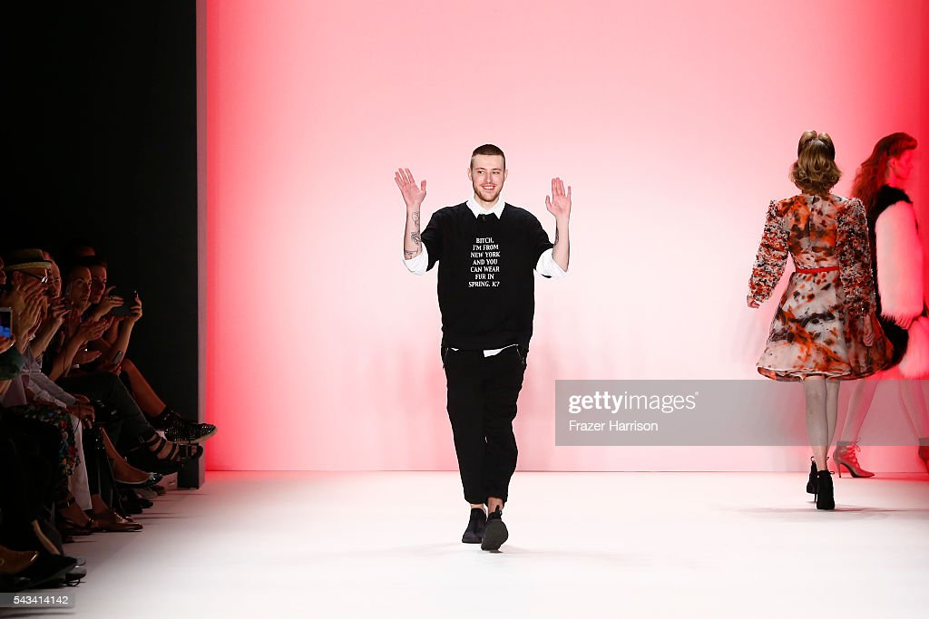 Designer Thomas Hanisch acknowledges the applause of the audience at the Thomas Hanisch show during the Mercedes-Benz Fashion Week Berlin Spring/Summer 2017 at Erika Hess Eisstadion on June 28, 2016 in Berlin, Germany.