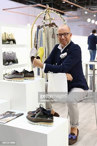 Designer Thomas Rath poses for a photograph at his booth during the first day of the GDS Global Destination for Shoes Accessories tradeshow on July...