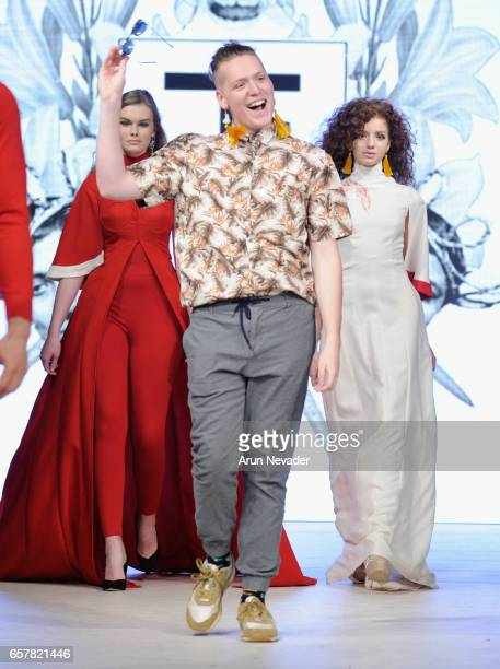 Designer Tieler James walks the runway at Vancouver Fashion Week Fall/Winter 2017 at Chinese Cultural Centre of Greater Vancouver on March 25 2017 in...