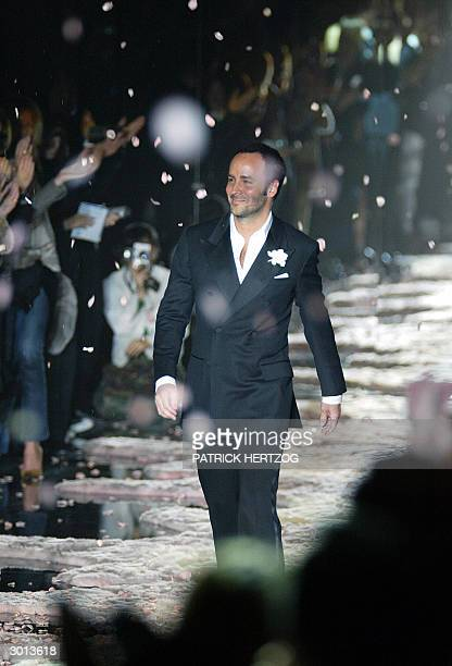 US designer Tom Ford aknowledges applauses on the catwalk at the end of his last Gucci Autumn/Winter 20042005 women' collection as part of the Milan...