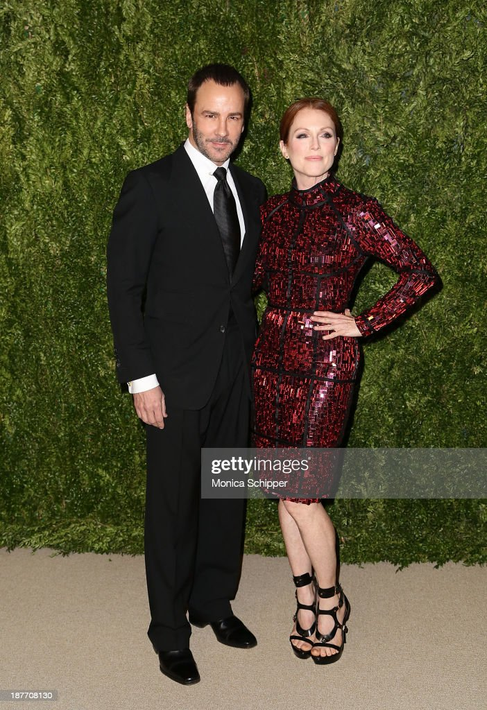 Designer Tom Ford and actress <a gi-track='captionPersonalityLinkClicked' href=/galleries/search?phrase=Julianne+Moore&family=editorial&specificpeople=171555 ng-click='$event.stopPropagation()'>Julianne Moore</a> attend CFDA and Vogue 2013 Fashion Fund Finalists Celebration at Spring Studios on November 11, 2013 in New York City.Ê