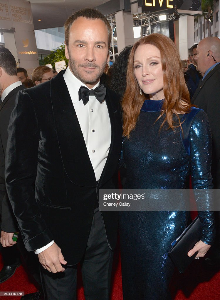 Designer Tom Ford and actress Julianne Moore attend the 73rd annual Golden Globe Awards sponsored by FIJI Water at The Beverly Hilton Hotel on...