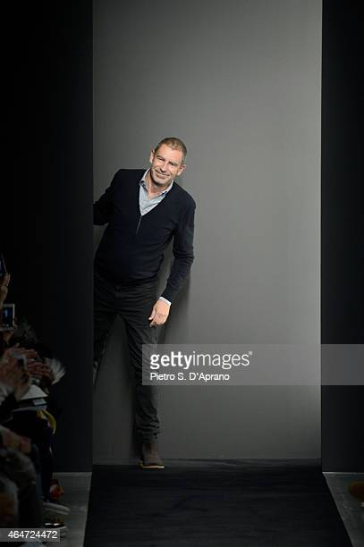 Designer Tomas Maier acknowledges the applause of the audience at the end of the Bottega Veneta show during the Milan Fashion Week Autumn/Winter 2015...