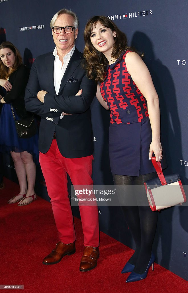 Designer Tommy Hilfiger (L) and actress Zooey Deschanel attend Zooey Deschanel and Tommy Hilfiger Debut New Capsule Collection at The London Hotel on April 9, 2014 in West Hollywood, California.