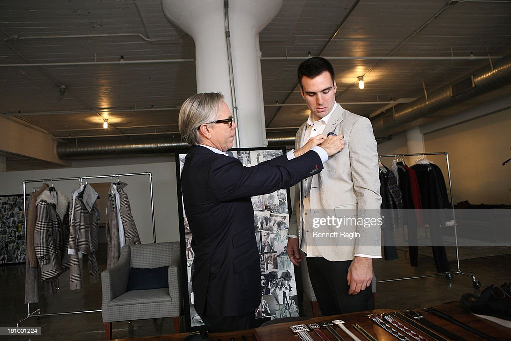 Designer Tommy Hilfiger and Baltimore Ravens Quarterback <a gi-track='captionPersonalityLinkClicked' href=/galleries/search?phrase=Joe+Flacco&family=editorial&specificpeople=4645672 ng-click='$event.stopPropagation()'>Joe Flacco</a> get ready for Fashion Week at Hudson Studios on February 7, 2013 in New York City.