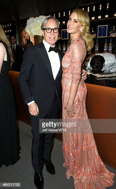 Designer Tommy Hilfiger and Dee Ocleppo attend the 2015 Vanity Fair Oscar Party hosted by Graydon Carter at the Wallis Annenberg Center for the...