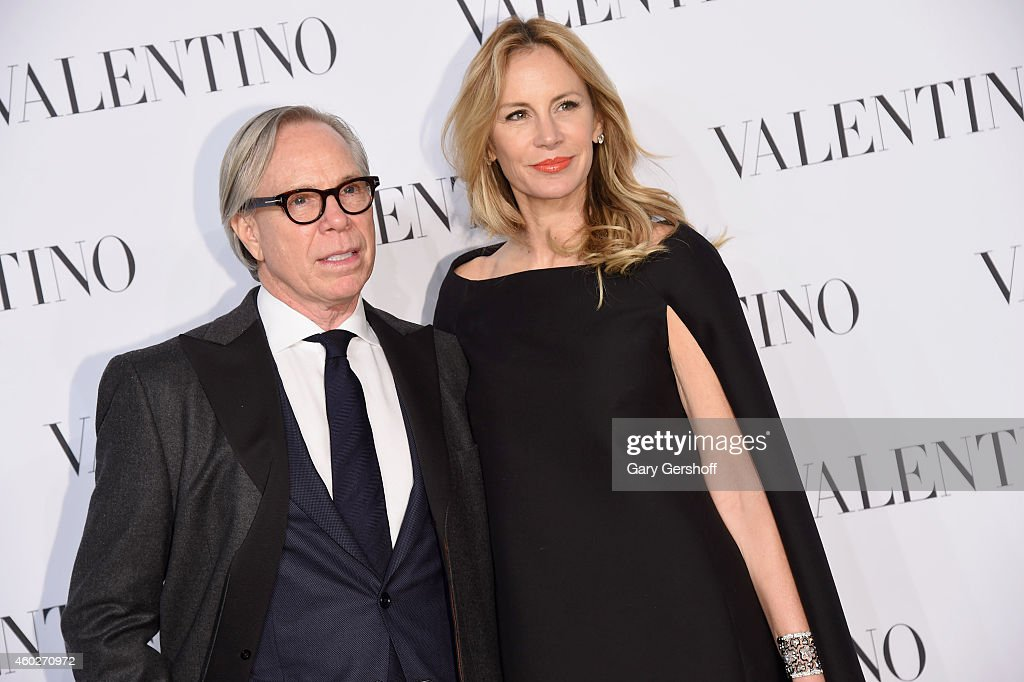 Designer Tommy Hilfiger (L) and Dee Ocleppo attend the Valentino Sala Bianca 945 Event on December 10, 2014 in New York City.