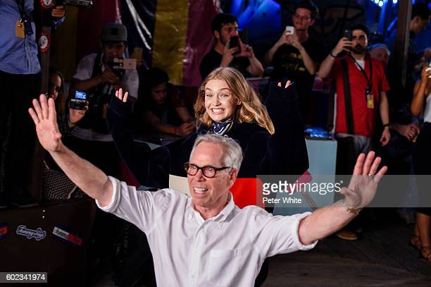 Designer Tommy Hilfiger and model Gigi Hadid walk the runway at Tommy Hilfiger Women's Fashion Show during New York Fashion Week at Pier 19 on...