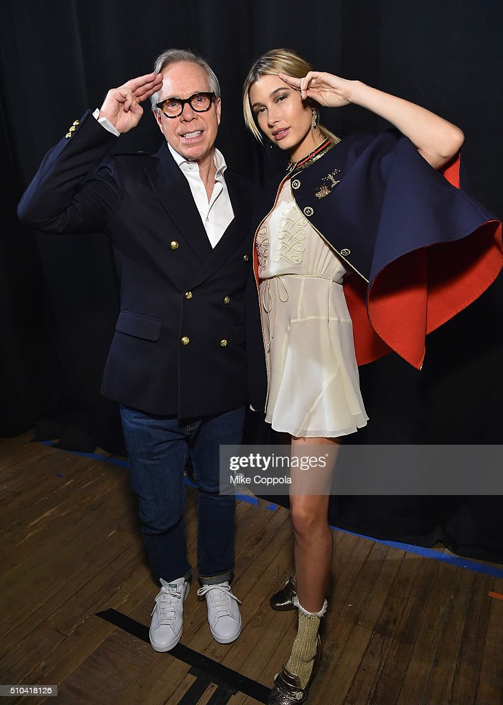 Designer Tommy Hilfiger and model Hailey Baldwin pose backstage at the Tommy Hilfiger Women's Fall 2016 show during New York Fashion Week The Shows...