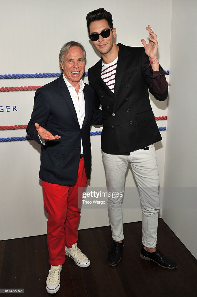 Designer Tommy Hilfiger and musician <a gi-track='captionPersonalityLinkClicked' href=/galleries/search?phrase=Gabe+Saporta&family=editorial&specificpeople=4214209 ng-click='$event.stopPropagation()'>Gabe Saporta</a> pose backstage at the Tommy Hilfiger Men's Spring 2013 fashion show during Mercedes-Benz Fashion Week at Maritime Hotel on September 7, 2012 in New York City.