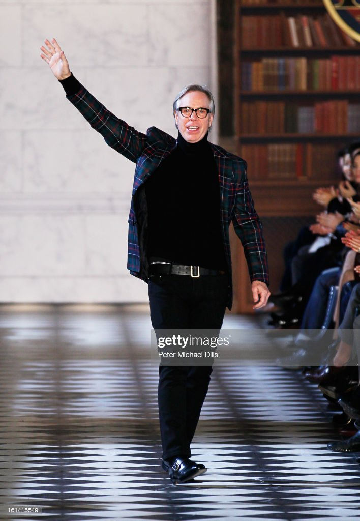 Designer Tommy Hilfiger appears on the runway after the Tommy Hilfiger Women's Fall 2013 fashion show during Mercedes-Benz Fashion Week at Park Avenue Armory on February 10, 2013 in New York City.