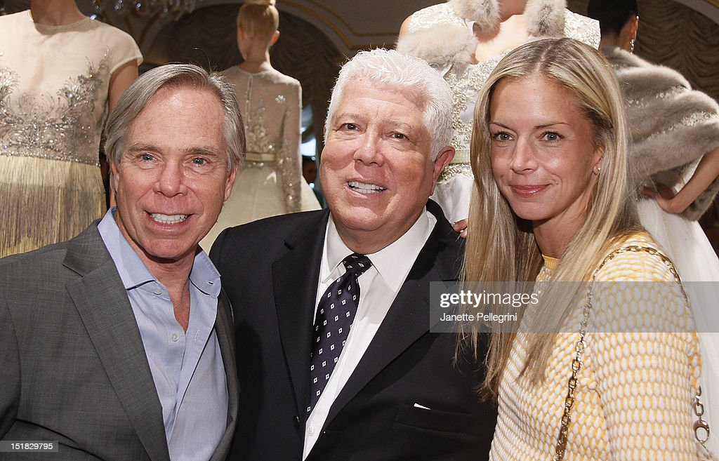 Designer Tommy Hilfiger, Designer Dennis Basso and <a gi-track='captionPersonalityLinkClicked' href=/galleries/search?phrase=Meredith+Melling+Burke&family=editorial&specificpeople=216377 ng-click='$event.stopPropagation()'>Meredith Melling Burke</a> attend the Dennis Basso spring 2013 presentation during Mercedes-Benz Fashion Week at the St. Regis Hotel on September 11, 2012 in New York City.