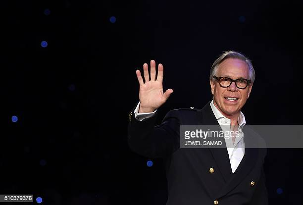 US designer Tommy Hilfiger greets the audience after presenting his creations during the Fall 2016 New York Fashion Week on February 15 in New York /...
