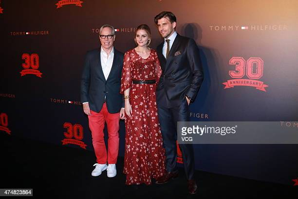 Designer Tommy Hilfiger Olivia Palermo and Johannes Huebl attend Tommy Hilfiger's 30th Anniversary at 751DPARK on May 26 2015 in Beijing China
