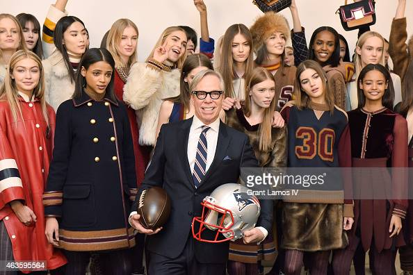 Designer Tommy Hilfiger poses with models at hair makeup for the Tommy Hilfiger Fall 2015 Women's Collection show during MercedesBenz Fashion Week...