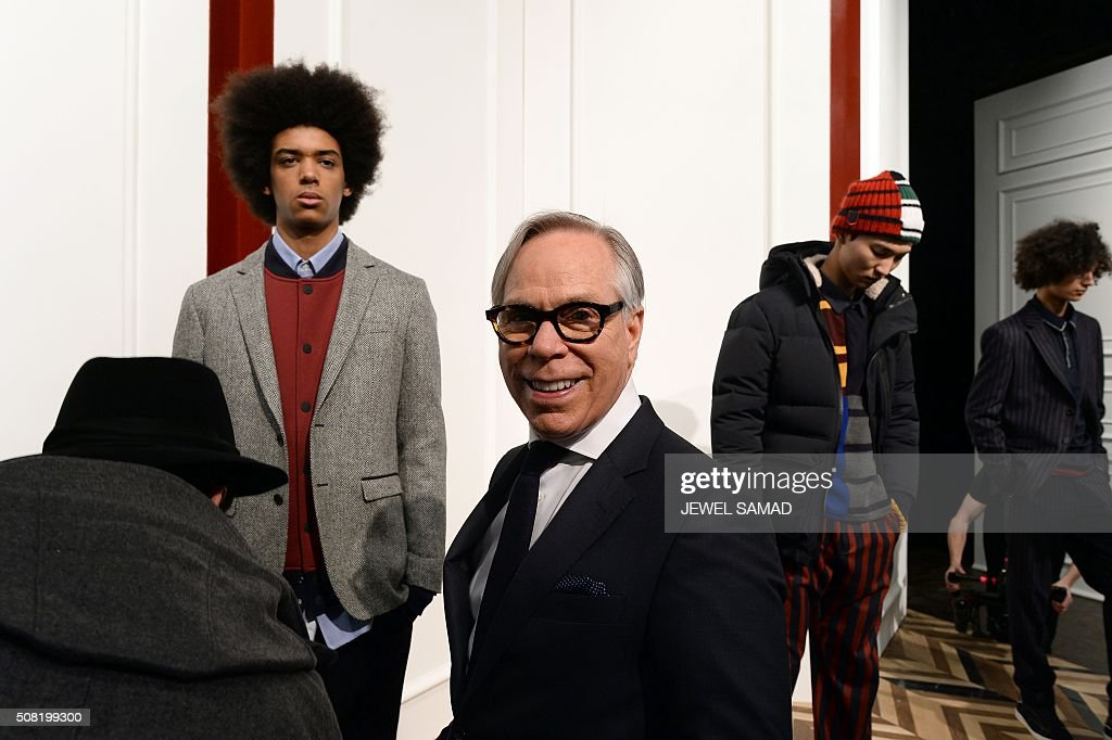US designer Tommy Hilfiger smiles as models present his creations during the New York Men's Fashion Week on February 3 in New York / AFP / JEWEL SAMAD